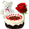 Luscious Cake added with small Teddy Bear and crimson Rose to Udaipur