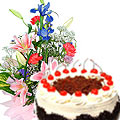Majestic assorted Seasonal Flowers along with lip smacking Black Forest Cake  to Gurgaon