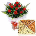 Stunning 12 Red Roses added with nutritious Dry Fruits  to India