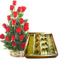 Bright charming 18 Red Roses and delicious mixed Sweets to Bhavani