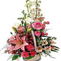 Exquisite colourful mixed Flowers in a basket to Bhavani