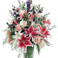 Gorgeous arrangement of fresh Lilies to Bhavani