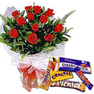 Dozen Red Roses with Cadburys Chocolate Celebration BoxAssorted cadburys chocolates to Ambur