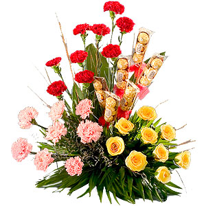 Attractive colourful 25 Flowers and 18 delicious Ferrero Rocher Chocolates gift hamper to Bhavani