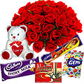Small Teddy, Assorted Cadbury Chocolates and 12 Red Roses Bouquet to Ranchi