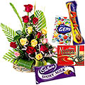 Pretty 15 rich Roses with tasty Cadburys Chocolates to India