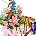 Seasonal Flowers Arrangement with Assorted Cadbury Chocolates to Phagwara