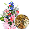 Charming Seasonal Flowers with healthy Dry Fruits to Gurgaon