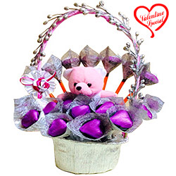 Delightful Chocolates and Teddy in a Basket to Behrampur