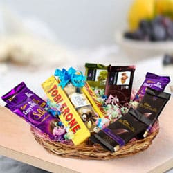 Tasty Assorted Chocolates Gifts Basket to Attur