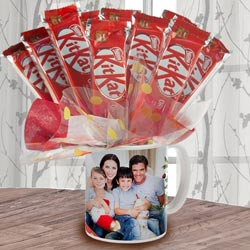 Delectable Bouquet of Kitkat in Personalized Coffee Mug to Aizawl