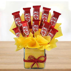 Remarkable Arrangement of Kitkat Chocolates in Glass Vase to Behrampur