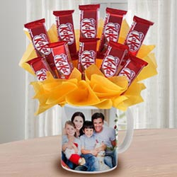 Enticing Kitkat Chocolates Arrangement in Personalized Coffee Mug to Ambalamugal