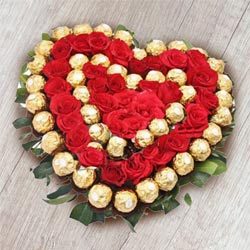 Heart Shaped Ferrero Rocher n Red Roses Arrangement to Anuparpalayam