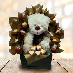 Marvelous Teddy with Handmade Chocolates Arrangement to Ahmedgarh