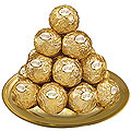 Dexterously Sequenced Ferrero Rocher Chocolates in a Golden Plated Thali to Mumbai