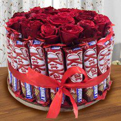 Delightful Arrangement of Kitkat with Red Roses to Amalampuram