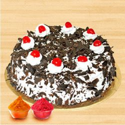 Scrumptious Black Forest Cake with free Gulal/Abir Pouch to Baghalkot
