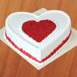 Fabulous 12 Red Roses with 1 Kg Love Cake to Barasat