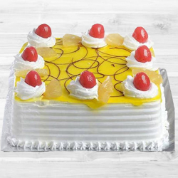 Delicious Eggless Pineapple Cake to Gurgaon