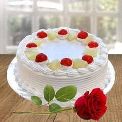 Wonderful cherishable Vanilla Cake combined with Red Rose to Bhimavaram