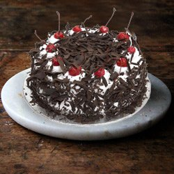 3/4 Star Bakerys Spell-Bounding 4.4 Lb Black Forest Cake to Guwahati