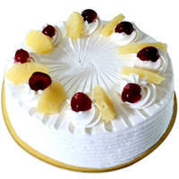 Tempting Eggless Pineapple Cake to Bhubaneswar