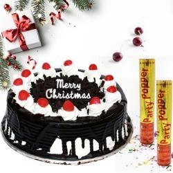 Flavored Black Forest X_mas Cake with Party Poppers to Jamshedpur