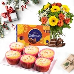 Marvelous Combo of Muffins with Chocolates n Flowers Bouquet for X_Mas	 to Aleppy