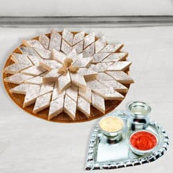 Silver Plated Paan Shaped Puja Aarti Thali (weight 52 gms) with Haldiram Kaju Katli to Ahmedabad