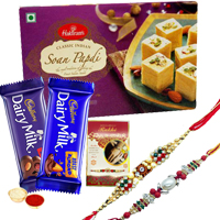 Divine Treat with Haldirams and Cadbury Chocolate Gift Hamper with Two Rakhis With Free Rakhi Card and Roli Tilak Chawal to India