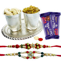 Delicious Dry Fruits Hamper in Silver Plated Glasses and Tray with Cadburys Dairy Milk Fruit n Nut to India