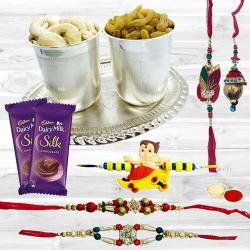Delicious Dry Fruits Hamper in Silver Plated Glasses and Tray with Cadbury Dairy Milk Silk n Family Set Rakhi to Nakoda