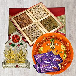 Assorted Dry Fruits with Pooja Thali, Ganesh Idol N Chocolates to Ahmedabad