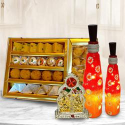 Magnificent Bottle Art Lamp Set with Antique Ganesh Laxmi Mandap n Assorted Sweets to Adugodi