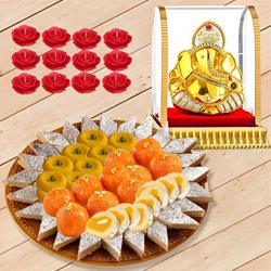 Auspicious Vighnesh Ganesh Idol with Bhikarams Sweets Platter n Candle Set to Ahmadnagar