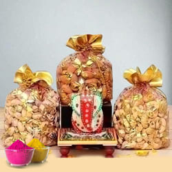 Pious Marble Ganesha with Dry Fruits for Holi to Adoor