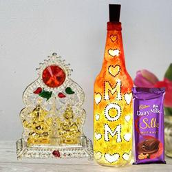 Handcrafted Bottle Lamp with Ganesh Laxmi Mandap n Cadbury Dairy Milk Silk Fruit n Nut for Mom to Alwar