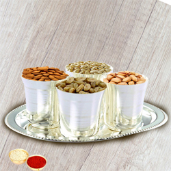 Delicious Dry Fruits added with Silver Glasses and Silver Tray with free Roli Tilak and Chawal to Aligarh