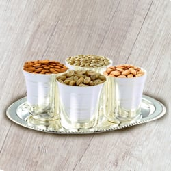 Delicious Dry Fruits added with Silver Glasses and Silver Tray to Hubli
