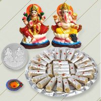 Ganesh Lakshmi with Kaju Pista Rolls from Haldiram to Belgaum
