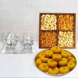 Sacred Gift of Silver Plated Ganesh Lakshmi with Sweets and Dry Fruits to Ancharakandy