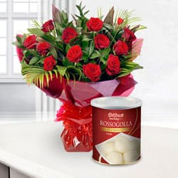 12 fresh Red Roses with 1 Kg Haldiram Rasgulla to Bangalore