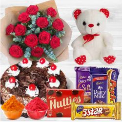 Ravishing 12 Dutch Red Roses with appetizing Cake and Cadburys Chocolate delight and Teddy Bear to Baghalkot