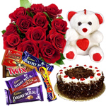 12 Exclusive  Dutch Red  Roses  Bouquet with Cake , Assorted Cadbury Chocolates and  a Cute Teddy Bear