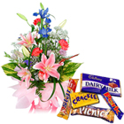 Seasonal Flowers Arrangement with Assorted Cadbury Chocolates to Calicut