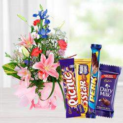 Stunning Assorted Flowers Arrangement with Mixed Cadbury Chocolate  to Alwar