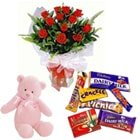 Glorious Red Roses with little Teddy Bear along with Cadburys Chocolate combo set to Vasco