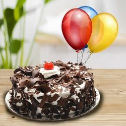 Happy and Tantalizing Black Forest Cake with Balloons to Hyderabad