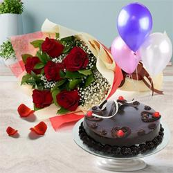 Appealing 1/2 Kg Truffle Cake with 6 Red Roses Bunch and 3 Balloons to Guwahati
